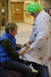 Lynn Johnston signs Dr. Simon Says lab coat