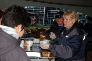 Volunteers serve chilli