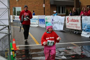 Daugher beats Dad to Finish